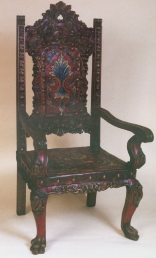Isabellina Armchair with hand tooled leather, hand carved wood and polychrome finish