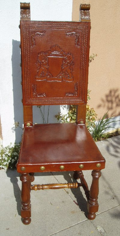 hand tooled leather chair family crest