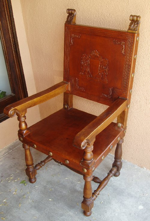 hand tooled leather armchair family crest